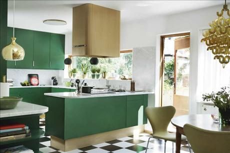 green kitchen cabinets. black and white checkered floor