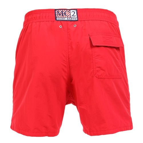 RED OWNER SWIM SHORTS WITH EMBROIDERY WRITING Solid red OWNER long Swim Shorts. Saint Barth LA COTONE DU VENT MC2 embroidery on front at lateral side. Two side pockets. Back Velcro flap pocket. MC2 label on waist to the reverse. Elastic waistband with adjustable drawstring. Internal net. COMPOSITION: 100% NYLON. Model wears size M, he is 189 cm tall and weighs 86 Kg.