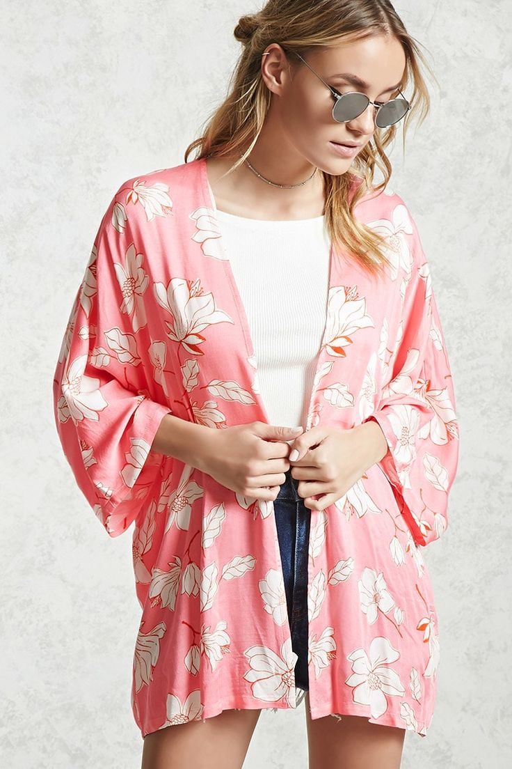 A lightweight woven kimono featuring an allover floral print, open front and 3/4 dolman sleeves.