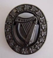 Vulcanite harp brooch