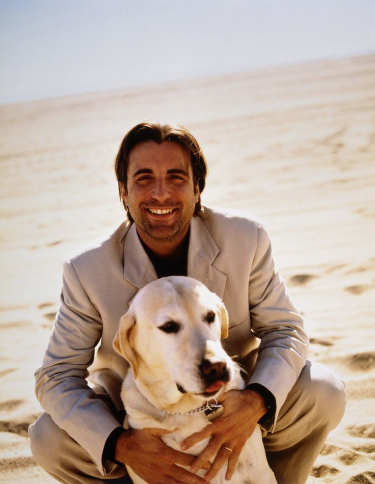 Andy Garcia.  I like this picture of him and his dog looking very relaxed instead of the mean and moody look.