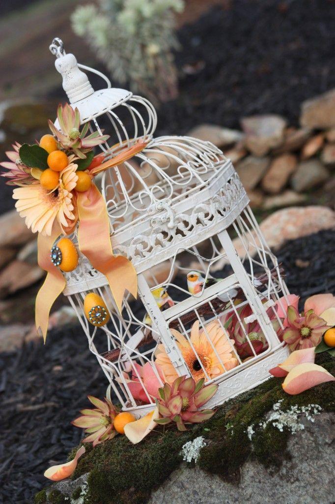 Birdcage centerpiece with orange flowers :) beautiful