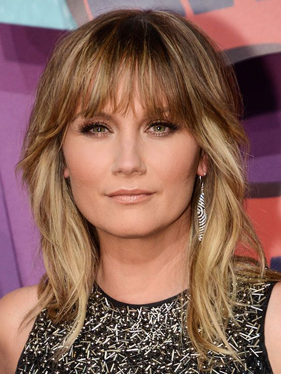 Jennifer Nettles  Long shag and wispy eyebrow-skimming bangs give a modern rocker-girl vibe. Perfect for naturally wavy texture hair.