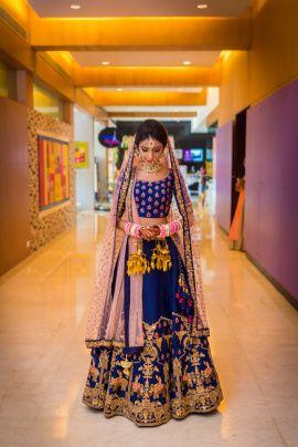 Bridal Wear - Eham & Nami wedding story | WedMeGood | Blue and Pink Wedding Lehenga with a Net Dupatta and Gold Embroidery #wedmegood #indianbride #indianwedding #bridal #lehenga #gold #bridallehenga #weddinglehenga #blue