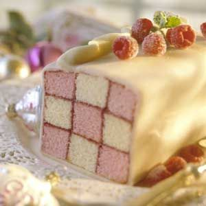 This checkerboard loaf cake recipe calls for two pound cake mixes, raspberry jam, purchased marzipan, and fresh raspberries and mint leaves. Make the centerpiece dessert to serve at a luncheon or tea party.