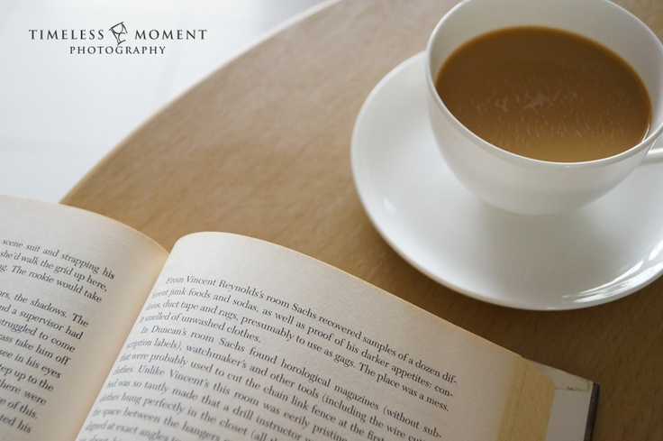 A cup of cappuccino and a good book for coffee break by Timeless Moment Photography