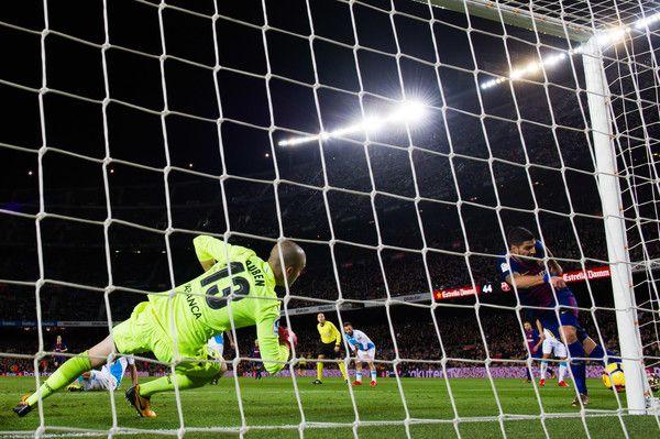 Ruben Martinez of Deportivo La Coruna saves a shot made by Luis Suarez of FC Barcelona during the La Liga match between FC Barcelona and Deportivo La Coruna at Camp Nou on December 17, 2017 in Barcelona.