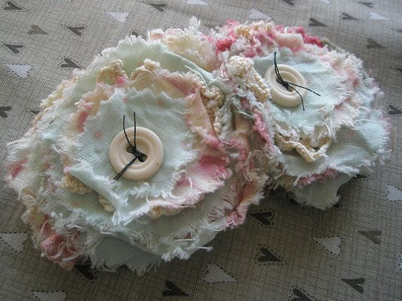 Rag flowers - These would  be so cute on throw pillows of maybe pink/white plaid....maybe with some lace??