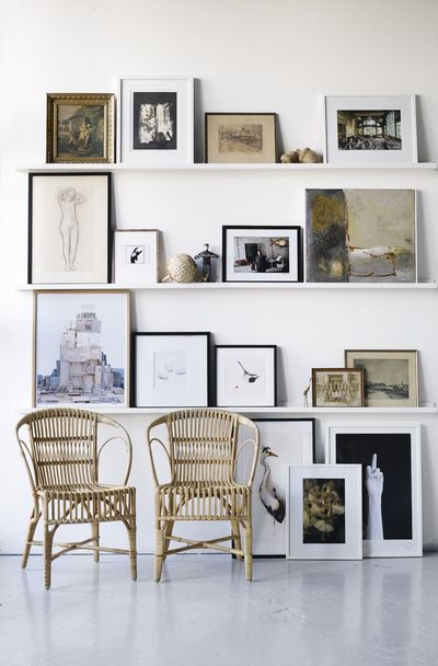 gallery wall with picture shelves.