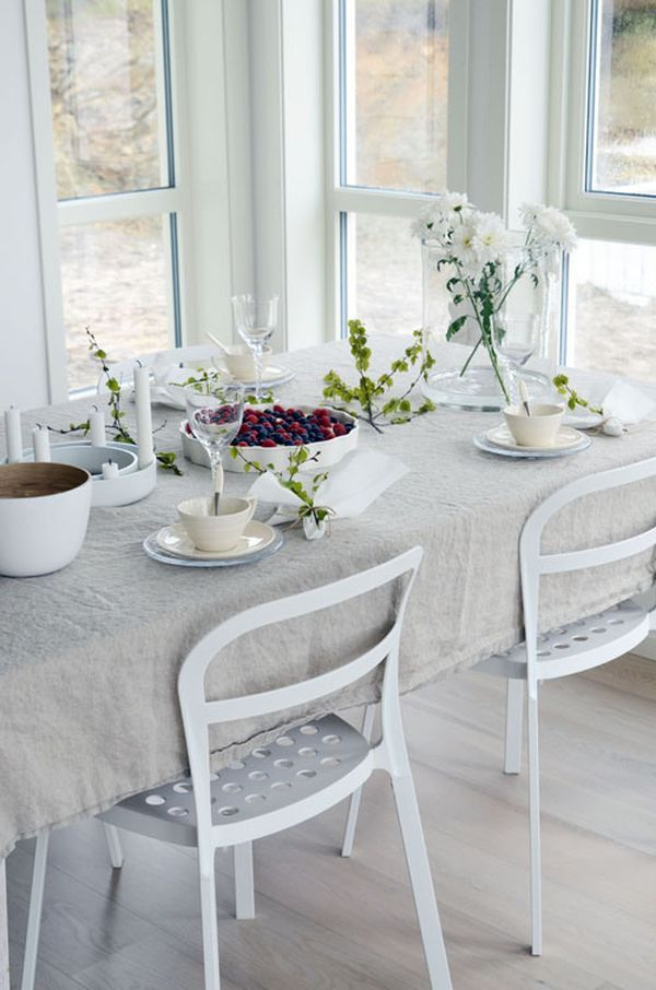 For a cozier dining room feel you can cover the table and maintain simplicity at the same time