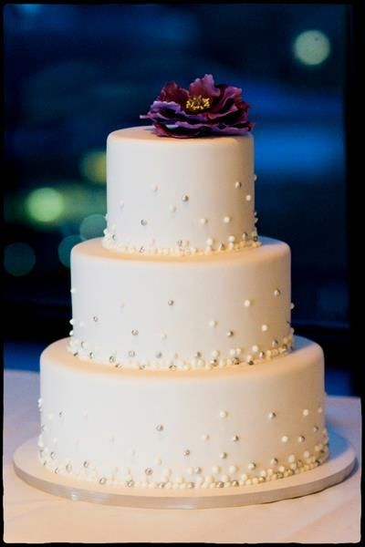 Modern, pearl encrusted three tiered wedding cake. Traditional wedding cakes gallery.