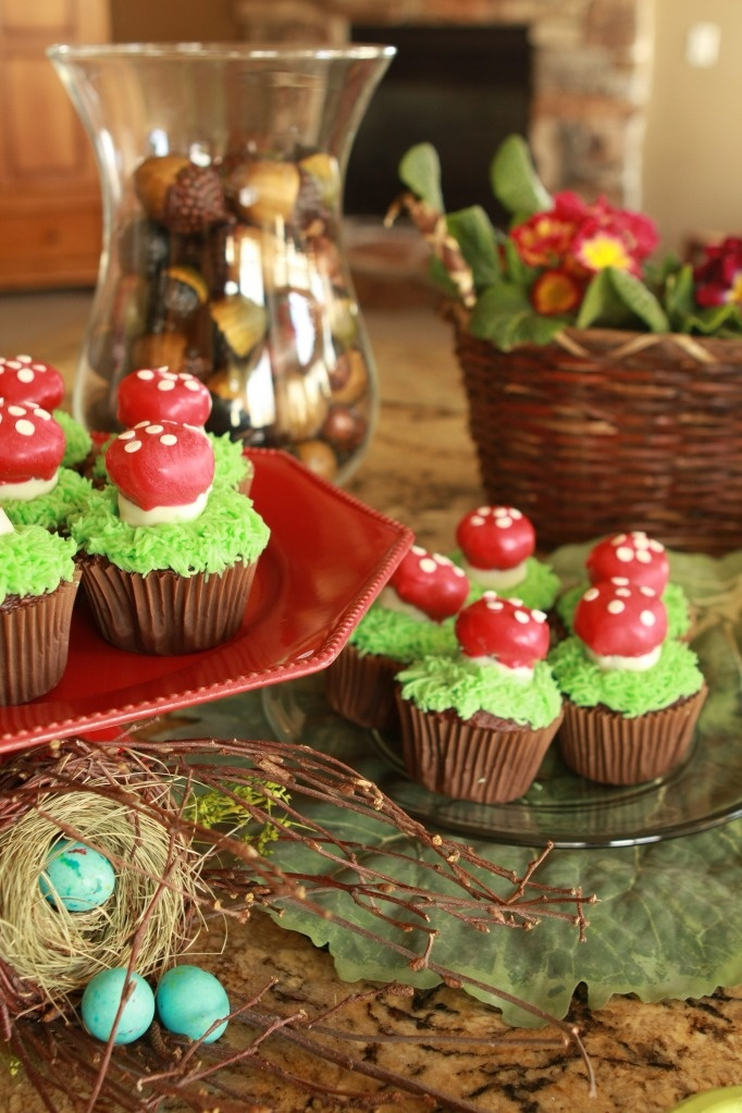Table setting with toadstool cupcakes