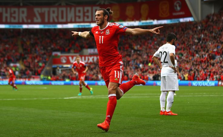 Gareth Bale of Wales celebrates scoring the opening goal during the FIFA 2018 World Cup Qualifier Group D match between Wales and Georgia at Cardiff City Stadium on October 9, 2016 in Cardiff, Wales.