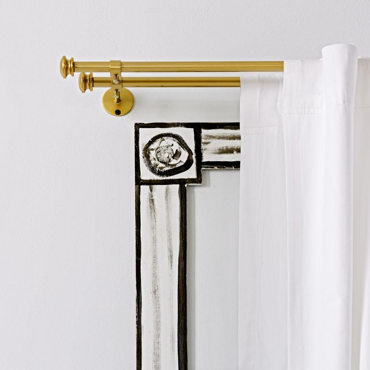 This sturdy and stylish double metal curtain rod is the perfect combo of function and fashion.