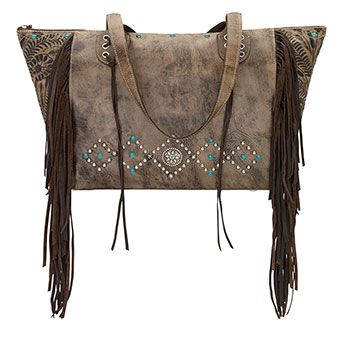 Zip-top carry-all fringe tote. Distressed charcoal brown genuine leather is hand-tooled, hand-stained, and accented with soft leather fringe and long flowing tassels. Decorated with top stitch detail and a southwestern spot design of silver spots, turquoise spots and a decorative concho that completes the look. #ziptop #carry #carryall #concho #purse #handbag #distressed #fringe #pungoridge #westernbootsales