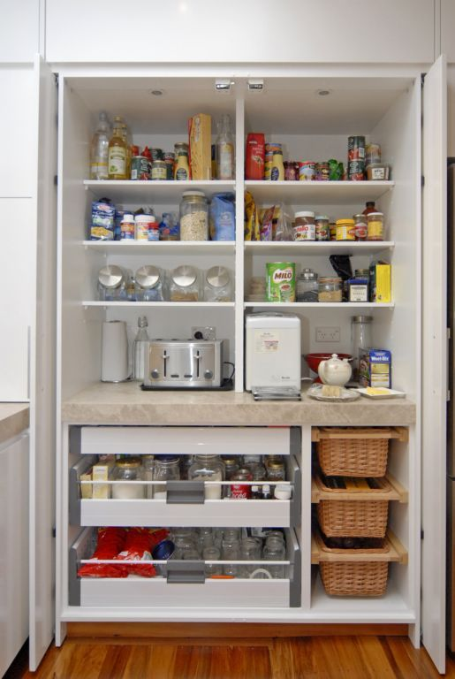 Pantry with pocket doors that can be tucked away.