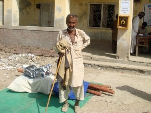"""After the floods in Pakistan, """"We need a house to live in and we need food to survive. But, we have no money to rebuild our home."""" - Achar, 62. CWS provided Achar and his son with shelter and other aid."""