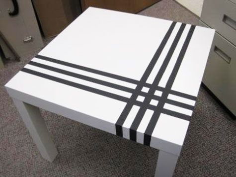 Pinstripe an IKEA Lack table. I have 2 of these tables in black, great idea!