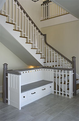 love this built in bench with storage in this open foyer