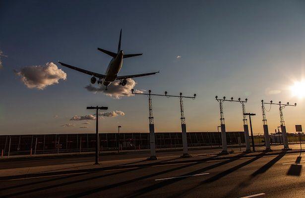 Plane landing during sunset in Toronto
