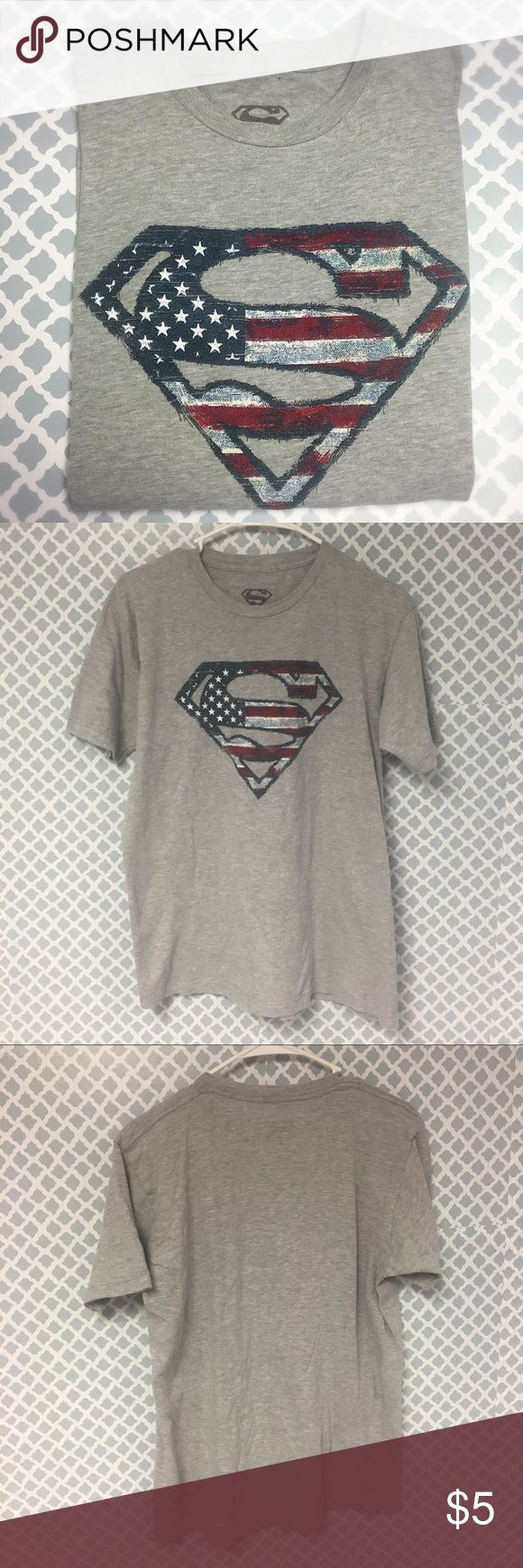 Superman American Flag T Shirt Description: American Flag red white and blue superman t shirt men's size large  🔘Condition: Good – A couple of pin sized holes and some slight fading  🔘Material: 100% cotton  🔘Measurements:       Pit to Pit – 21 inches       Shoulder to Hem – 27 inches    ⭐️ 15% Off All Bundles! 🛍    💞Thanks for stopping by! 😘 Inventory: B Superman Shirts Tees - Short Sleeve