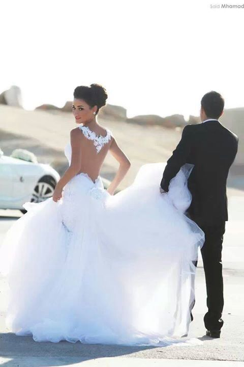 oh my gosh. that dress. are you kidding me?! seriously the most beautiful thing I've ever seen. hands down. <3
