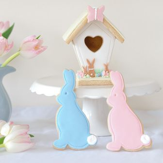 Iced biscuits for Easter, with Spring birdhouse, all completely edible and made from vanilla biscuit.  Available from www.nilaholden.co.uk