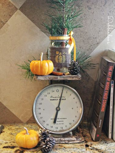Squares of burlap, fall stencils, and colorful ribbon are all you need to turn a Mason jar into a rustic autumn tableau.