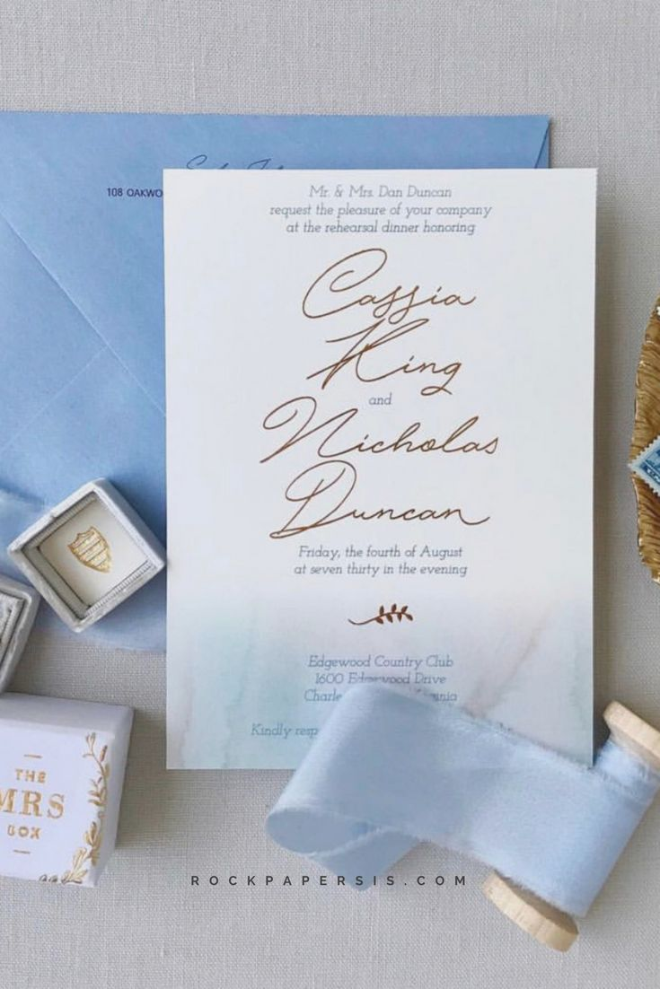 Rose gold and dusty blue rehearsal dinner