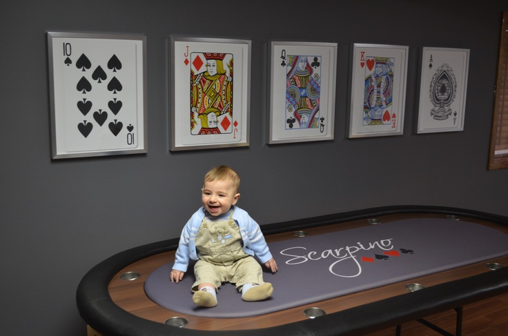 Brady loves our poker room. I designed the poker table top and ordered it the day Brady was born. Cards were custom ordered from Petek Design on Etsy. Custom poker table. Grey wall poker room. Playing card art. Poker art.