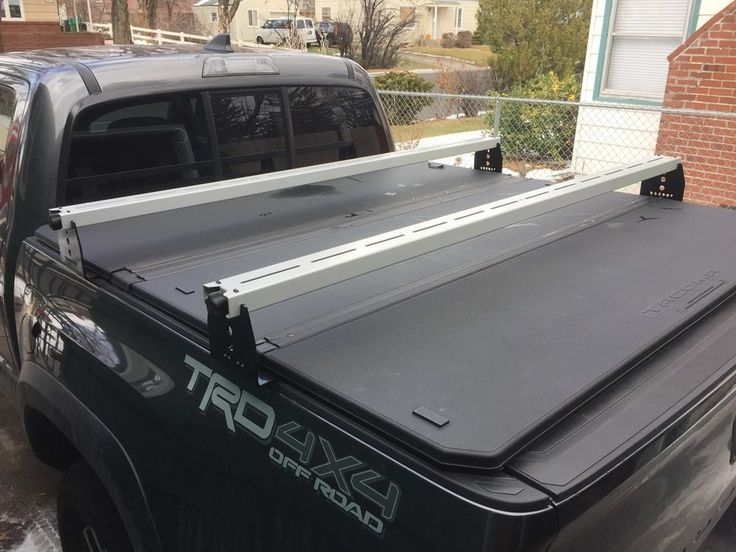 For tonneau cover owners who want to carry their toys over the bed. - Constructed of powder coated steel  - Perfect for Roof Top Tents, ski racks, bike racks, and cargo baskets - Works with 2005 - 2017 Tacomas - Each bracket attaches to bed cleat rail with two bolts for maximum strength - Crossbars