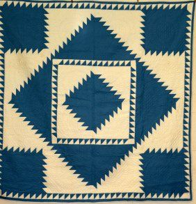 """Delectible Mountains circa 1940; hand-quilted sawtooth diamond pattern in cottons with feather on diamond patterns, 80""""x 78"""""""