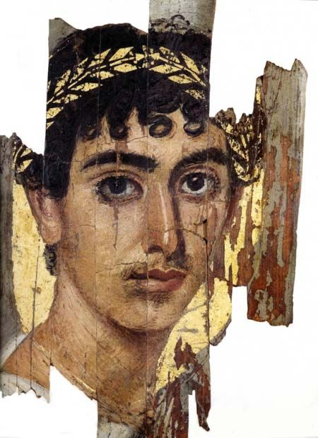 Roman encaustic on wood mummy portrait of a young man with wreath from Fayyum, Egypt, 1st-3rd century AD.: