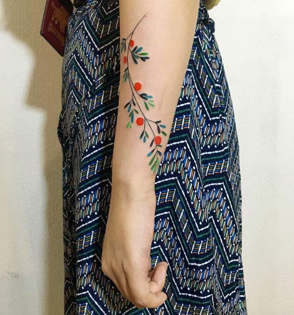 Floral forearm tattoo by Zihee