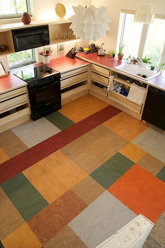 Linoleum Remnant Kitchen Floor. Another view - colours too earthy for me, but a juicy palette would be good. Love the stripe. The stripe is win. Picture orange stripe on grey floor.