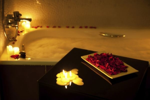 FOR BOTH: Candles & rose petal bath. Draw a bath for someone you love. (This is certainly not for someone you just met.) This is inexpensive but can be very thoughtful and romantic.