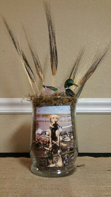 Centerpieces for tables. Rehearsal dinner with duck hunting theme. Just slide favorite hunting pictures in front of moss.