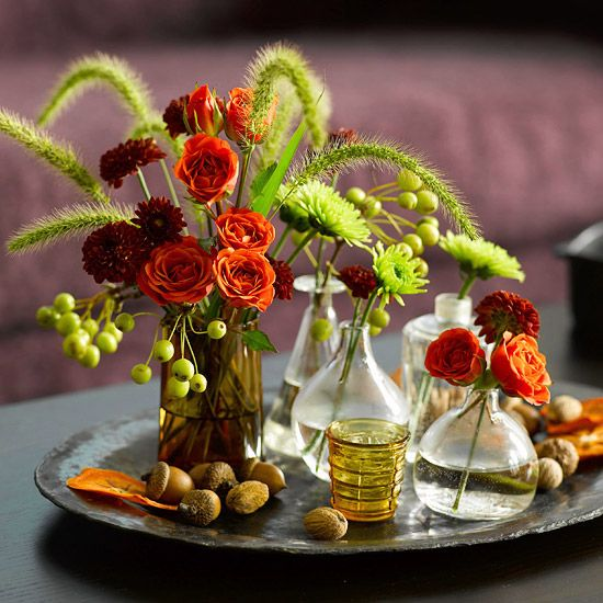 Use unique bottles for an easy way to display fall colors and blooms: http://www.bhg.com/halloween/decorating/creative-fall-centerpieces-featuring-natural-elements/?socsrc=bhgpin091914bottleflowerarrangement&page=23
