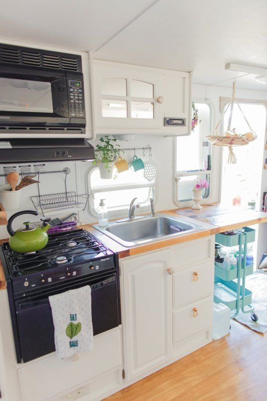 Patrick & Anna's Treasure-Filled and Travel-Ready Camper — House Call // camper kitchen
