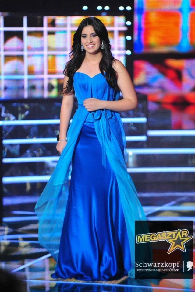 Gigi Radics, winner of Hungarian talent show 'Megasztár' in a turquoise Daalarna evening gown