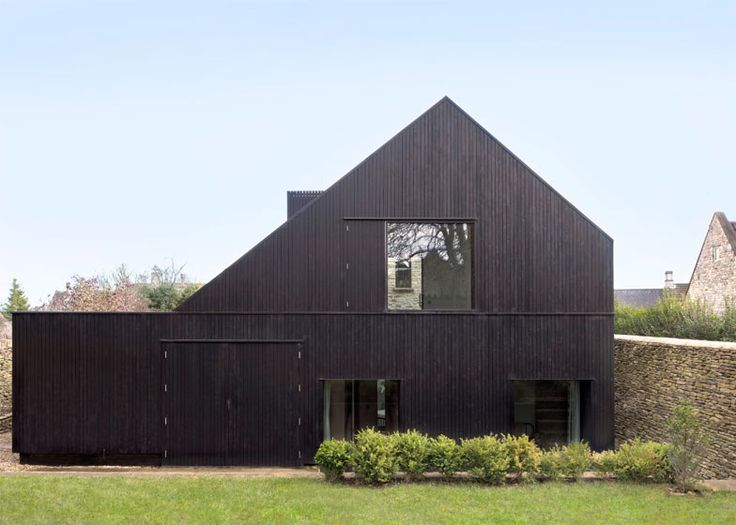 London studio Jonathan Tuckey Design has converted a historic chapel in Wiltshire, England, into a house with a blackened-timber extension conceived as the building's shadow.
