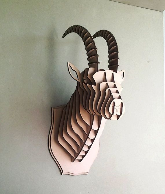 I really like the way the corrugated cardboard panels are placed in this manner to mimic the appearance of a goat. However, I do not quite know who made this.