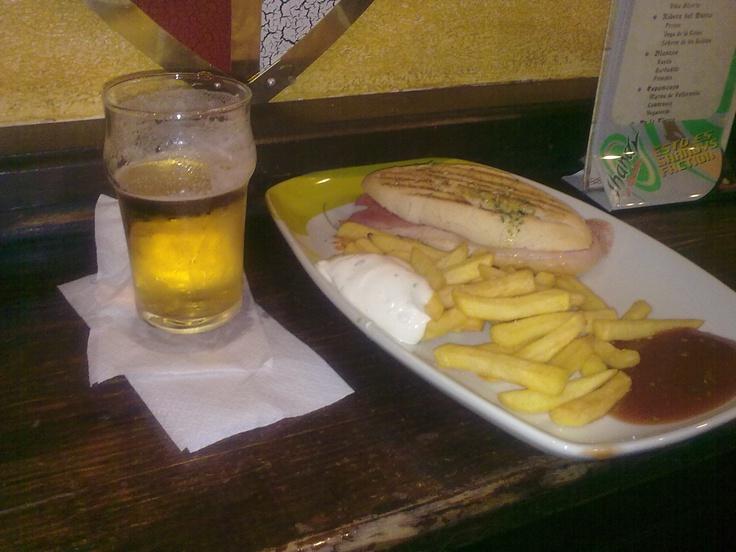 Tapas in Granada. Cerveza, patatas y bocadillo jamon serrano.