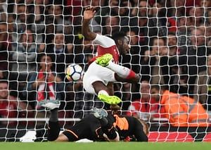 Aug. 11th. 2017: Danny Welbeck collides with Kasper Schmeichel as he scores Arsenal's second goal in a 4-3 win over Leicester City