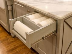 An open-face drawer with a built-in paper towel dispenser makes the towels easy to reach but it is not an obvious part of the kitchen. Design by John McGilvray. See more of this beautiful French country kitchen >>
