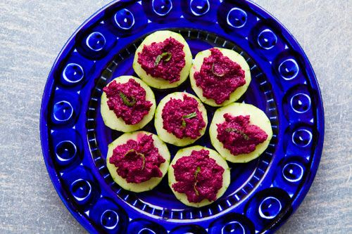 BEET HUMMUS I ate this entire batch, save one teaspoon that my mother caught just in time, before it was all finished off.  1/2 pound beets (about 4 medium sized beets), scrubbed clean, cooked, peeled, and cubed*  2 Tbsp tahini sesame seed paste  5 Tbsp lemon juice  1 small clove garlic, chopped  1 Tbsp ground cumin  1 Tbsp lemon zest (zest from approx. 2 lemons)  Generous pinch of sea salt or Kosher salt  Fresh ground pepper to taste