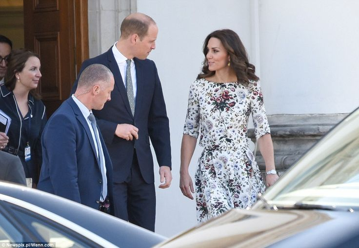 Kate and William chatted as they made their way out of a building in Warsaw to make the jo...