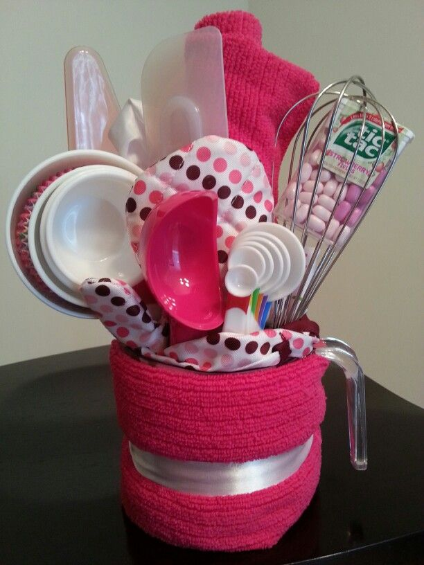 Pink birthday gift for a young baker   I made this for my niece for her 7th birthday. She loves to help in the kitchen so I got a bunch of baking related utensils and put them in a 16oz/2cup measuring cup. I found a kids size apron, mitten, and chef hat at KMart and the rest at Walmart. Total cost was less than $30. Here is a list of items included.... -Apron -Mitten -Chef hat -Whisk -Spatula -Cake cutter -Ice cream/melon scooper -Dry Measuring cups(large and small) -Tic tacs -16oz/2cup…