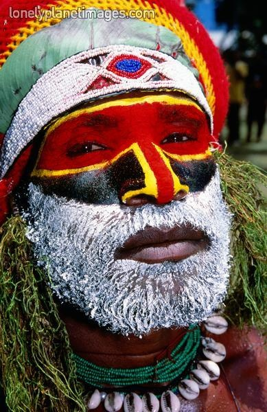 Portrait of man from Mara group in tribal face paint. - Lonely Planet