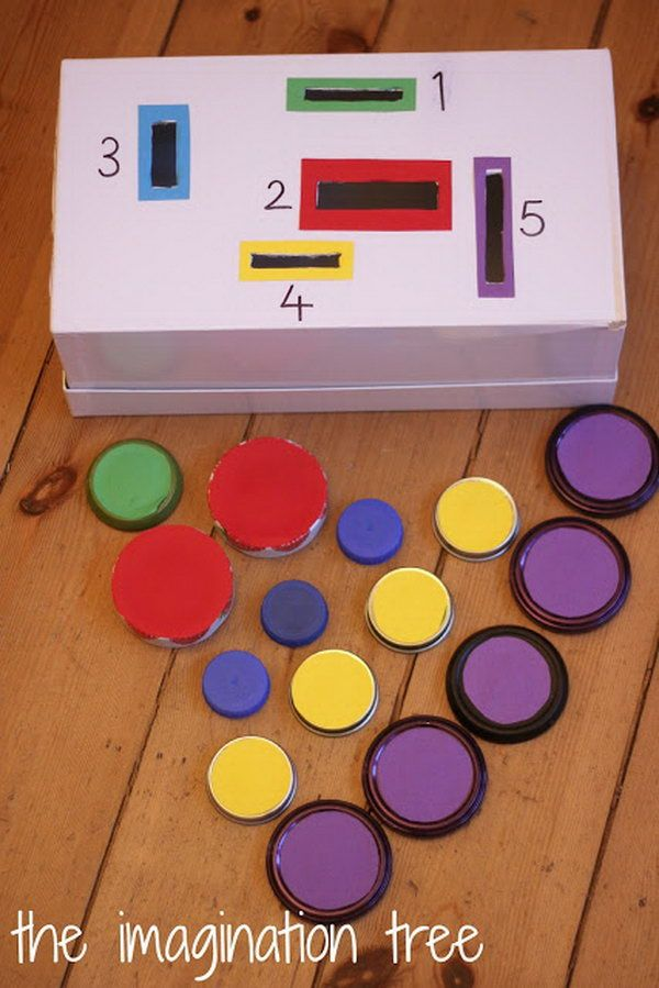 Make a count and sort posting box for fine motor practise and problem solving. The enduring appeal of dropping and posting through holes will make this a real favourite game. http://hative.com/diy-ideas-with-bottle-tops/